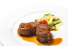 Hot Meat Dishes - Veal Medallions. With Zucchini and Cherry Tomato Royalty Free Stock Image