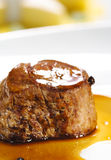 Hot Meat Dishes - Veal Medallions. Selective Focus on Foreground Stock Photo