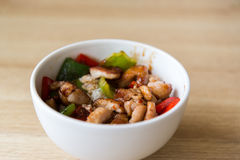 Hot meat salad in white plate Stock Photo