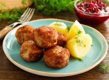 Hot meatballs with boiled potatoes Stock Photography
