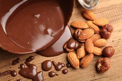 Hot melted chocolate and almond nuts. Sweet food chocolate dipped melted chocolate chocolate almonds nobody photography closeup Royalty Free Stock Photography
