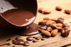 Hot melted chocolate and almond nuts. Sweet food chocolate dipped melted chocolate chocolate almonds nobody photography closeup Stock Images