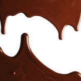 Hot melted chocolate. Pouring on the white background stock images