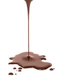 Hot melted chocolate pouring on white background Royalty Free Stock Photos
