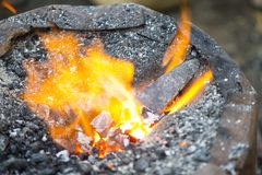 Hot metal arrow blade in the fire Stock Photography