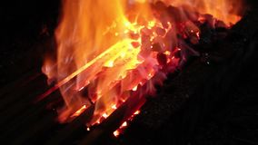 Hot metal in a blacksmith forge. stock footage