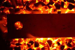 A hot metal plate with a hole. Royalty Free Stock Photography