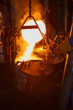 Hot metal separate to small ladle Stock Photo