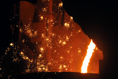 Hot metal and sparks close up the photo was made ??in a steel plant located in ukraine Royalty Free Stock Photography