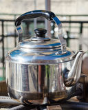 A hot metallic tea kettle Stock Photos