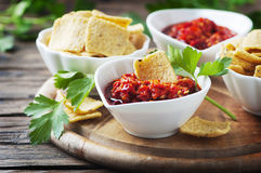 Hot mexican salsa with chili peppers. Selective focus Stock Photography