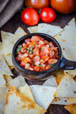 Hot mexican salsa - spicy dip with nachos - chips from corn Stock Photos