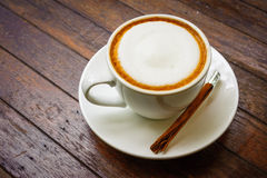Hot milk  coffee on wooden table Royalty Free Stock Photography