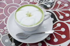 Hot milk green tea. Stock Photo