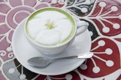 Hot milk green tea. Stock Photo