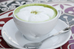 Hot milk green tea. Stock Photos