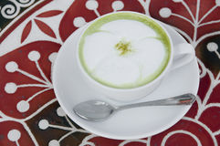 Hot milk green tea. Stock Images