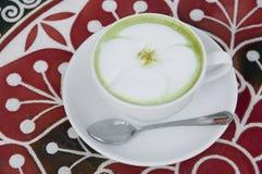 Hot milk green tea. Stock Images
