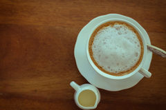 Hot milk  Latte coffee on wooden tabl Royalty Free Stock Photo