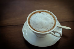 Hot milk  Latte coffee on wooden table Royalty Free Stock Photo