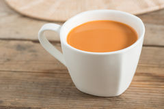 Hot milk tea in a white cup. Selective focus. Royalty Free Stock Image