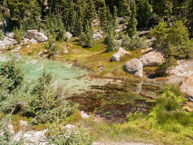 Hot mineral pool in mountain valley Stock Photo
