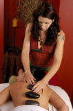 Hot Mineral Stone Massage Stock Image