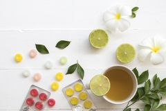Hot mix honey lemon herbal health care sore throat and cough. With lozenge on background white Stock Image