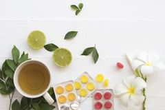 Hot mix honey lemon herbal health care sore throat and cough. With lozenge on background white Royalty Free Stock Photography
