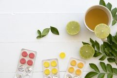 Hot mix honey lemon herbal health care sore throat and cough. With lozenge on background white Stock Photography