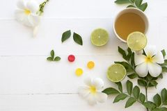 Hot mix honey lemon herbal health care sore throat and cough. With lozenge on background white Royalty Free Stock Photos