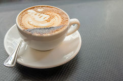 Hot Mocca Coffee with latte art in swan shape Royalty Free Stock Image