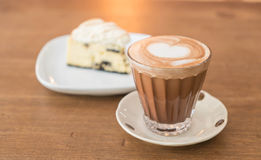 Hot mocha coffee with cake. Hot mocha coffee with cookies and cream cheese cake Royalty Free Stock Photo