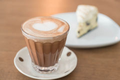 Hot mocha coffee with cake. Hot mocha coffee with cookies and cream cheese cake Stock Images