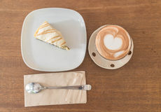 Hot mocha coffee with cake. Hot mocha coffee with cookies and cream cheese cake Royalty Free Stock Image