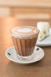 Hot mocha coffee with cake. Hot mocha coffee with cookies and cream cheese cake Stock Image