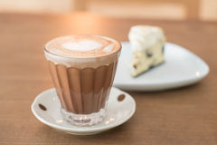 Hot mocha coffee with cake. Hot mocha coffee with cookies and cream cheese cake Stock Photo