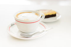 Hot mocha coffee. Mocha coffee drink and brownie cake on a white table Royalty Free Stock Image