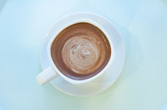 Hot mocha coffee serve in a white cup in the morning with pastel Royalty Free Stock Images