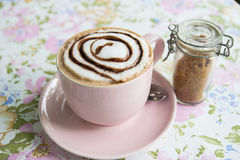 Hot mocha topping with foamy milk and chocolate sauce in pink cu Stock Photography