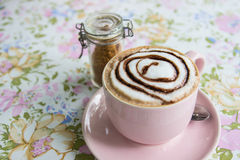 Hot mocha topping with foamy milk and chocolate sauce in pink cu Royalty Free Stock Image