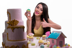 Hot model makes us sure in the taste of bakery Royalty Free Stock Images