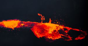 Hot, molten lava bubbles and rises into the sky in Hawaii stock photography