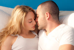 Hot in the morning. Attractive young couple in love, early morning  in bed Royalty Free Stock Images