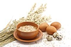 Hot morning porridge and eggs Stock Photo