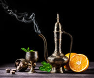 Hot Moroccan tea with mint and oranges Stock Images