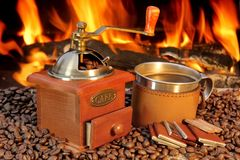 Hot mug of coffee by the fire Royalty Free Stock Image
