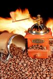Hot mug of coffee by the fire Stock Photography