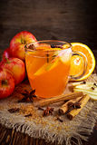 Hot Mulled apple cider with cinnamon, cloves, anise and Orange Royalty Free Stock Images