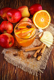 Hot Mulled apple cider with cinnamon, cloves, anise and Orange Royalty Free Stock Photo